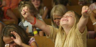 Christian evangelicals Children worshipping at the Harvestime Church of Eau Claire Wisconsin
