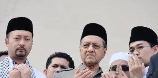 Dr. Mahathir Mohamad (center)